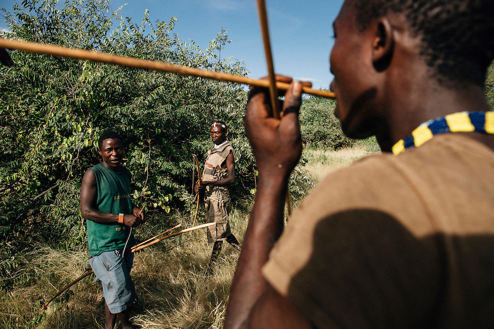 Male members of the Hadza tribe practice their archery skills one afternoon. Yaeda valley area in Northern Tanzania. Photo by Greg Funnell, March 2016.