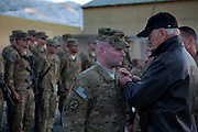 Vice President Joe Biden awards a Bronze Star to Staff Seargent Workman, at Forward Operating Base Airborne in Wardak Province, Afghanistan, January 11, 2011. (Official White House Photo by David Lienemann)