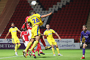 AFC Wimbledon defender Rod McDonald (26) battles to win a header during the EFL Trophy match between Charlton Athletic and AFC Wimbledon at The Valley, London, England on 4 September 2018.