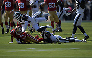 San Francisco 49ers tight end George Kittle (85) catches the ball while Los Angeles Rams cornerback Troy Hill (20) tackles during an NFL football game, Sunday, Oct. 13, 2019, in Los Angeles. The 49ers defeated the Rams 20-7. (Dylan Stewart/Image of Sport)
