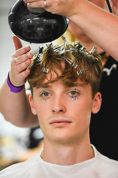 © Licensed to London News Pictures. 14/09/2019. LONDON, UK.  A model backstage is made ready ahead of the Simon Mo show during Fashion Scout SS20, an off schedule show at Victoria House in Bloomsbury Square, during London Fashion Week.  Photo credit: Stephen Chung/LNP