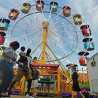 People walk in front of PBJ Happee Day Shows' new Ferris wheel, which made its Railroad Festival debut this year.
