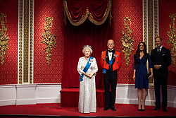 """The empty space left next to the figures of Queen Elizabeth II, the Duke of Edinburgh, and the Duke and Duchess of Cambridge, as Madame Tussauds London moved its figures of the Duke and Duchess of Sussex from its Royal Family set to elsewhere in the attraction, in the wake of the announcement that they will take a step back as """"senior members"""" of the royal family, dividing their time between the UK and North America."""