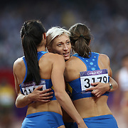 Mariya Ryemyen, Ukraine, (facing) congratulates team mates Elyzaveta Bryzgina (left) and  Olesya Povh after their heat win during the Women's 4 X 100m Heats at the Olympic Stadium, Olympic Park, during the London 2012 Olympic games. London, UK. 9th August 2012. Photo Tim Clayton
