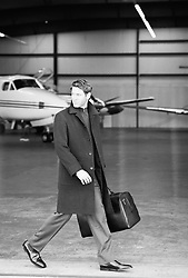 Businessman walking through a private airport hanger