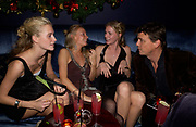 Poppy Delevigne, Martha Ward,  Chloe Delevigne and Marcus Langlands-Pierce, Tatler magazine Little Black Book party, Tramp. Jermyn St. 10 November 2004. ONE TIME USE ONLY - DO NOT ARCHIVE  © Copyright Photograph by Dafydd Jones 66 Stockwell Park Rd. London SW9 0DA Tel 020 7733 0108 www.dafjones.com