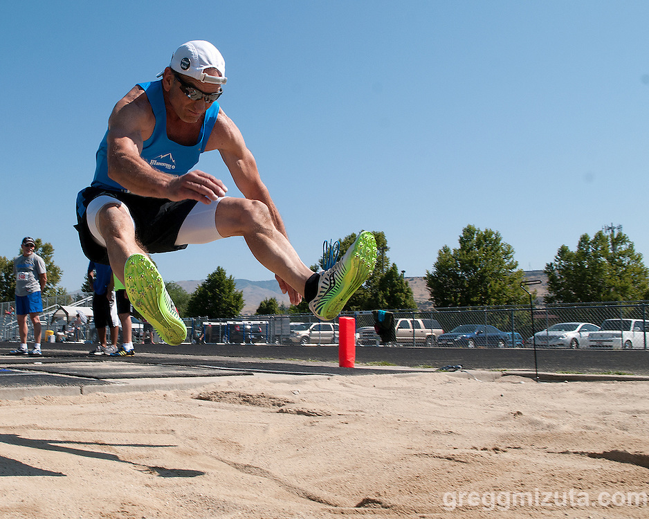 Daniel Packham triple jumps during the 2013 Idaho Senior Games Track &amp; Field meet at Timberline High School in Boise, Idaho on August 3, 2013. Packham finished first in the M60 Division with a jump of 33-06.75.<br /> <br /> Packham placed third in this event (M60 Triple Jump 33-00.50) at the 2013 National Senior Games on July 29, 2013 in Cleveland, Ohio.