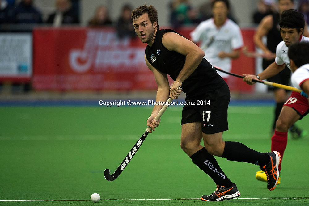 Nic Woods of New Zealand looks to pass during the Black Sticks Men v Japan international hockey match at the Coastlands Kapiti Sports Turf in Paraparaumu on Friday the 21st of November 2014. Photo by Marty Melville/www.Photosport.co.nz