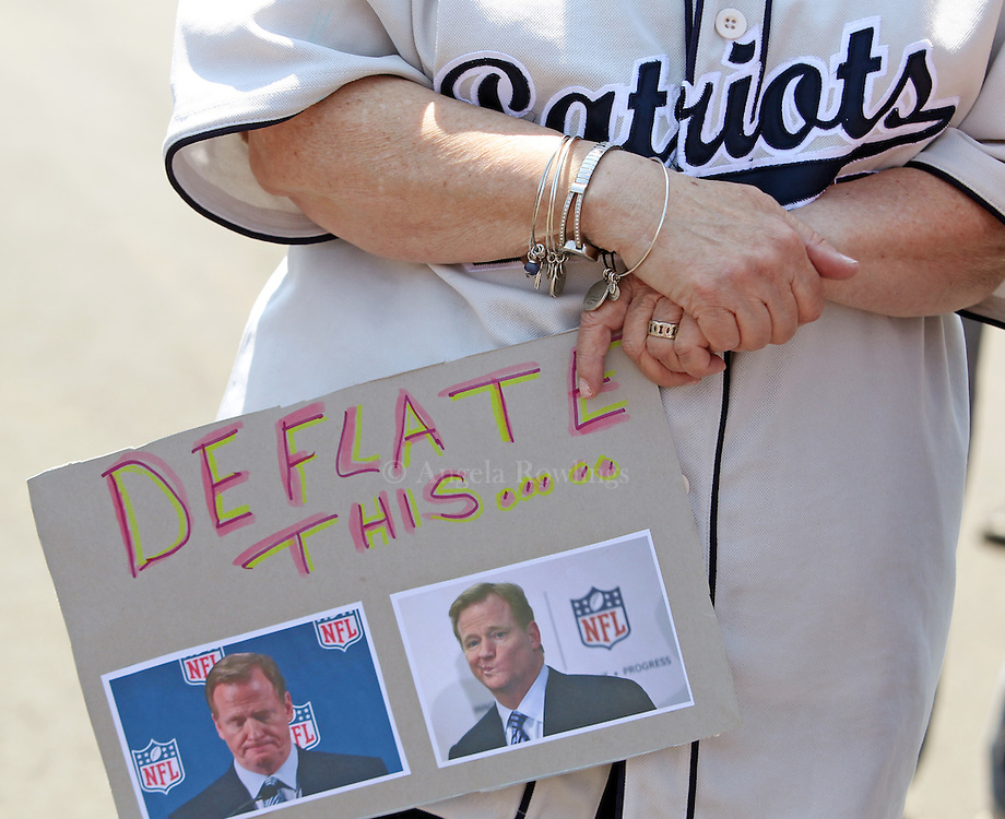 "(Foxboro, MA - 5/24/15) A woman carries a sign with photos of NFL Commissioner Roger Goodell during the ""Free Tom Brady"" rally at Gillette Stadium, Sunday, May 24, 2015. Staff photo by Angela Rowlings."