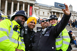 © Licensed to London News Pictures. 27/04/2019. London, UK.Police officers takes a selfie during the Vaisakhi Festival in Trafalgar Square hosted by the Mayor of London. <br /> The Vaisakhi Festival is a religious festival that marks the Sikh New Year. This year's celebrations took place on 14 April which commemorates the beginning of Sikhism as a collective faith and London's celebrations are an opportunity for people from all communities, faiths and backgrounds to experience a festival that is celebrated by Sikhs who live in the capital and over 20 million people across the world. Photo credit: Dinendra Haria/LNP