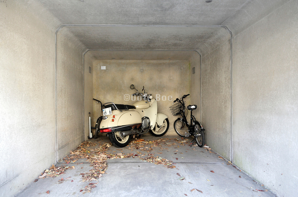 one car parking garage with a bicycle and a motorcycle