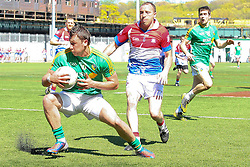 May 5, 2013; Bronx, NY; USA; Leitrim's Paul Brennan (10) makes a move on New York's Lonan Maguire (5) during the first half at Gaelic Park.