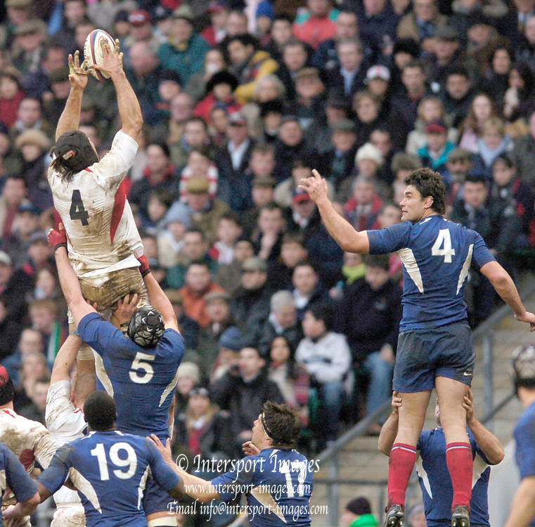 2005 RBS Six Nations, England v France, Twickenham, ENGLAND: French captain Fabien Pelous [right] watches as Danny Grewcock plucks the line out ball out of the air. .Photo  Peter Spurrier. .email images@intersport-images...