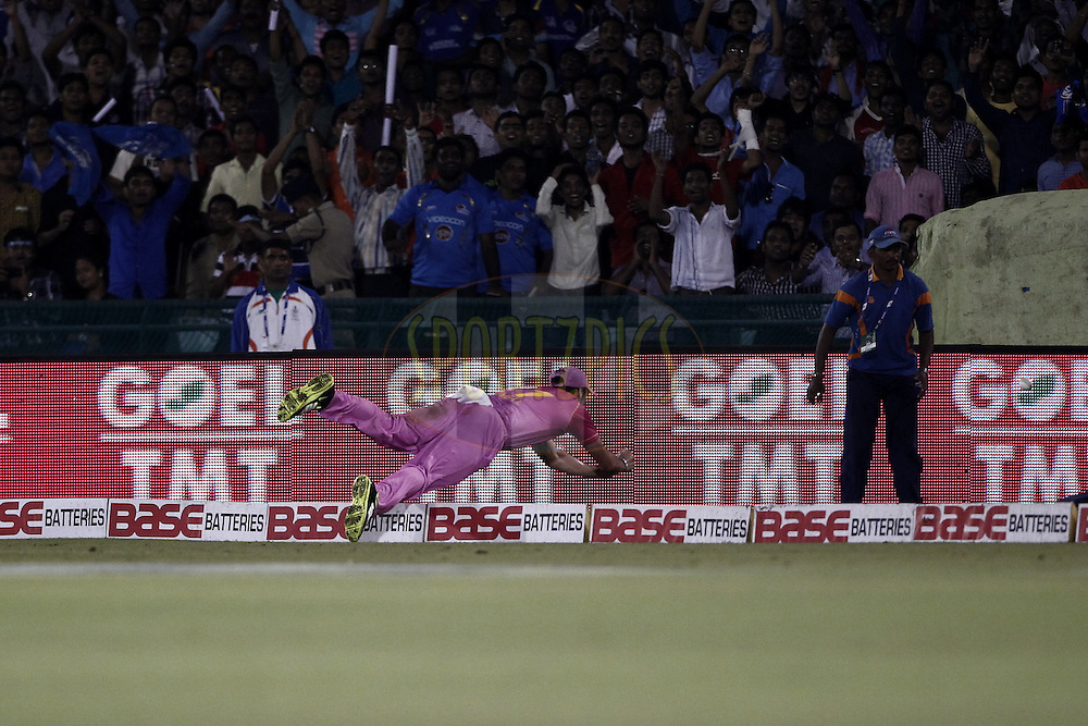 NORTHERN KNIGHTS Player trying to save run during the qualifier 1 match of the Oppo Champions League Twenty20 between the Northern Knights and the Southern Express held at the Chhattisgarh International Cricket Stadium, Raipur, India on the 13th September 2014<br /> <br /> Photo by:  Deepak Malik / Sportzpics/ CLT20<br /> <br /> <br /> Image use is subject to the terms and conditions as laid out by the BCCI/ CLT20.  The terms and conditions can be downloaded here:<br /> <br /> http://sportzpics.photoshelter.com/gallery/CLT20-Image-Terms-and-Conditions-2014/G0000IfNJn535VPU/C0000QhhKadWcjYs