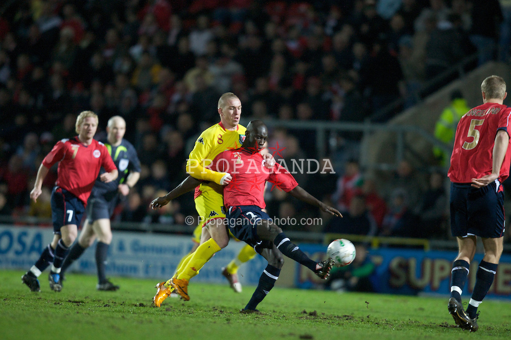 WREXHAM, WALES - Wednesday, February 6, 2008: Wales' Freddy Eastwood and Norway's Pa-Modou Kah during an international friendly match at the Racecourse Ground. (Photo by David Rawcliffe/Propaganda)