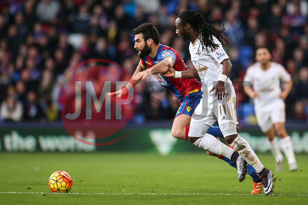 Mile Jedinak of Crystal Palace holds Marvin Emnes of Swansea City back off the ball - Mandatory byline: Jason Brown/JMP - 07966386802 - 28/12/2015 - FOOTBALL - London - Selhurst Park - Crystal Palace v Swansea City - Barclays Premier League