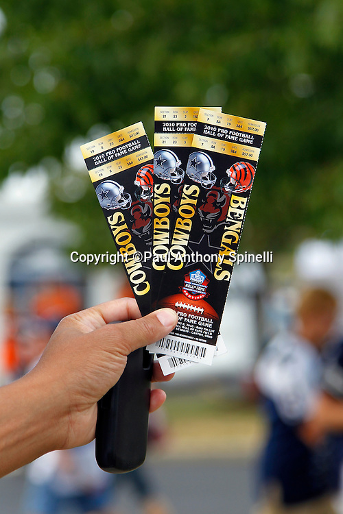 A ticket vendor sells tickets prior to the NFL Pro Football Hall of Fame preseason football game between the Dallas Cowboys and the Cincinnati Bengals on Sunday, August 8, 2010 in Canton, Ohio. The Cowboys won the game 16-7. (©Paul Anthony Spinelli)