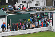 Spectators with umbrellas flood in to Lords via the North Gate as a heavy rain shower passes over which looks like it will delay the start of play on the final day at Lords ahead of the International Test Match 2019 match between England and Australia at Lord's Cricket Ground, St John's Wood, United Kingdom on 18 August 2019.