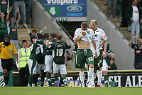 Photo: Lee Earle.<br /> Plymouth Argyle v Norwich City. Coca Cola Championship. 23/09/2006. Norwich's Carl Robinson (F) looks dejected as the Argyle team celebrate their third goal.