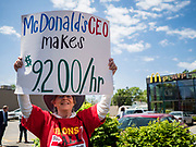 23 MAY 2019 - URBANDALE, IOWA: Union activists march around a McDonald's in Urbandale, a Des Moines suburb, to protest for a $15 an hour minimum wage and better worker safety in McDonald's. The activists were accompanied by Bill de Blasio, the mayor of New York City. De Blasio called on the fast food chain to raise its minimum wage to $15.00 per hour and improve worker safety. He joined the field of Democrats vying to be the party's candidate in the 2020 presidential election last week. Iowa traditionally hosts the the first election event of the presidential election cycle. The Iowa Caucuses will be on Feb. 3, 2020.                         PHOTO BY JACK KURTZ