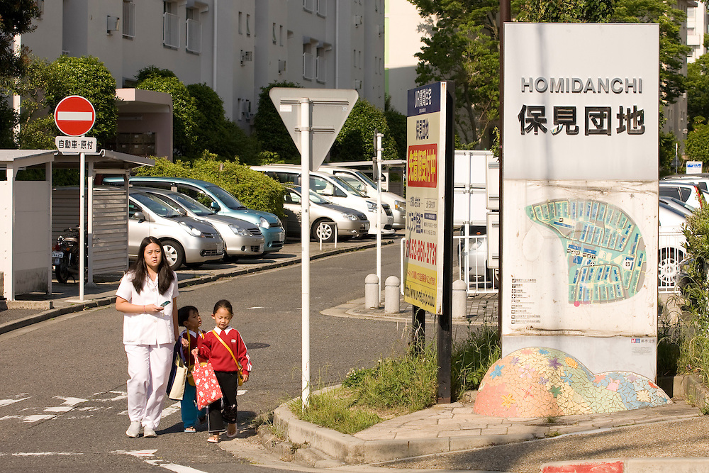 Mothers bringing their children to daycare before leaving to work.  ..Residents of the  Homi Danchi area of Toyota City,  Nearly all the  residents are Foreigners  with about 1/2 of them from Brazil. .. Most  work at Toyota Factories or companies  of  the Toyota Group.