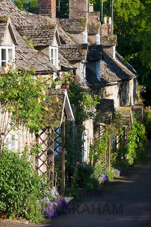 Traditional quaint period stone cottages in a terrace row in the Cotswolds in Winchcombe, Gloucestershire