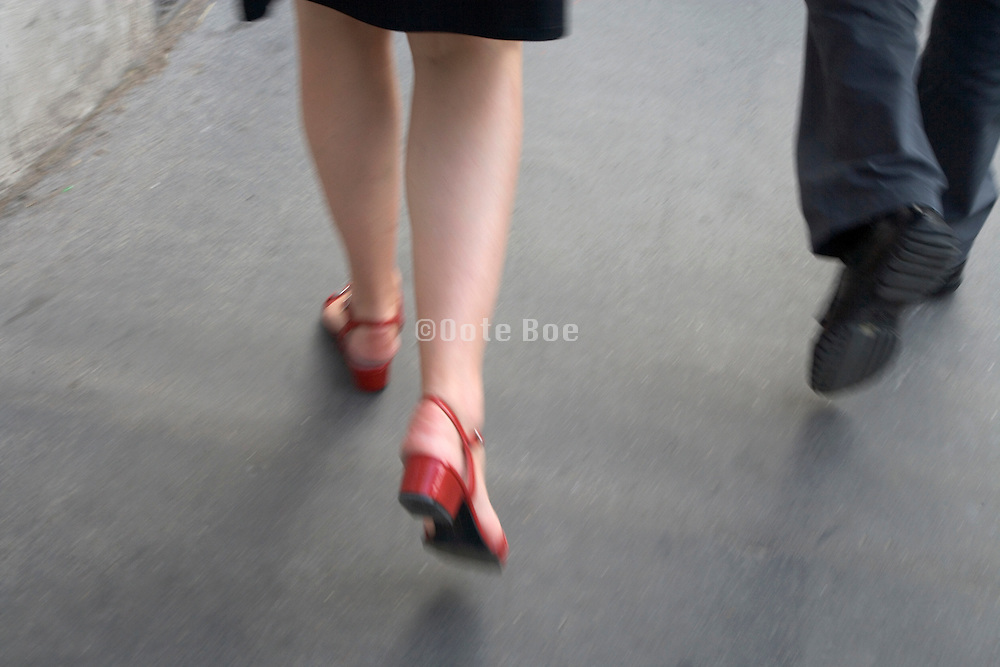 legs of a female walking with businessman