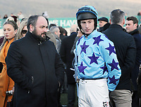 National Hunt Horse Racing - 2019 Cheltenham Festival - Thursday, Day Three (St Patrick's Day)<br /> <br /> Johnny Berry on Go Another One in the Parade ring with trainer, Warren Greatrex in the 17.30 Fluke Walwyn Kim Muir Challenge Cup Amateur Riders Handicap Steeple Chase (Class 2), at Cheltenham Racecourse.<br /> <br /> COLORSPORT/ANDREW COWIE