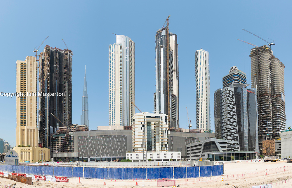 View of new high rise apartment towers under construction at Downtown Dubai , UAE, United Arab Emirates.