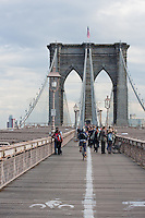 people crossing brooklyn bridge in New York City October 2008