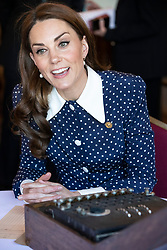 The Duchess of Cambridge using a German Enigma machine captured during WWII during a visit to Bletchley Park to view a special D-Day exhibition in the newly restored Teleprinter Building.