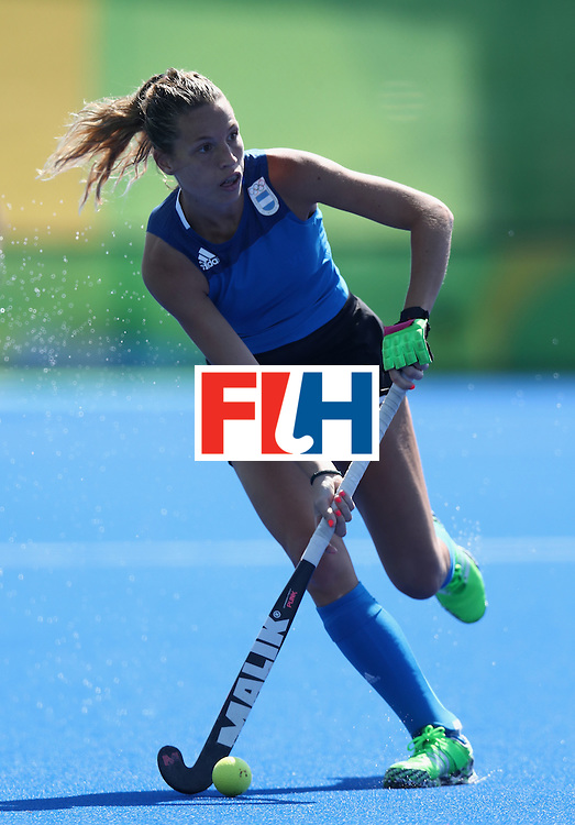 RIO DE JANEIRO, BRAZIL - AUGUST 13:  Delfina Merino of Argentina runs with the ball during the Women's pool B hockey match between Argentina and India on Day 8 of the Rio 2016 Olympic Games at the Olympic Hockey Centre on August 13, 2016 in Rio de Janeiro, Brazil.  (Photo by David Rogers/Getty Images)
