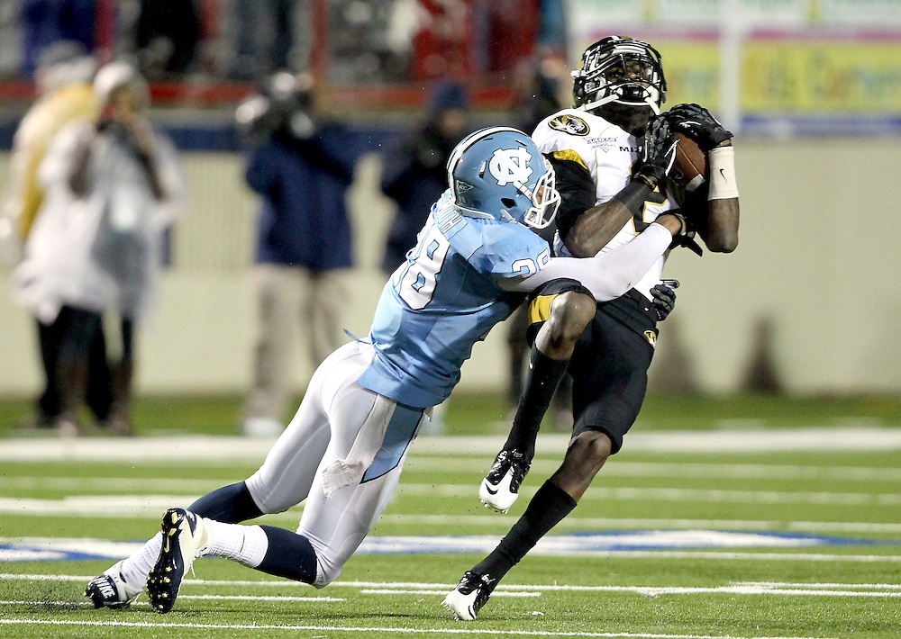Missouri wide receiver L'Damian Washington (3) is hit over the middle by North Carolina safety Jonathan Smith (28) after catching a pass in the third quarter of the Independence Bowl college football game in Shreveport, La., Monday, Dec. 26, 2011.
