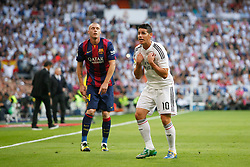 25.10.2014, Estadio Santiago Bernabeu, Madrid, ESP, Primera Division, Real Madrid vs FC Barcelona, 9. Runde, im Bild Real Madrid´s James (R) complains to the referee and Barcelona´s Mathieu (L) // during the Spanish Primera Division 9th round match between Real Madrid CF and FC Barcelona at the Estadio Santiago Bernabeu in Madrid, Spain on 2014/10/25. EXPA Pictures © 2014, PhotoCredit: EXPA/ Alterphotos/ Victor Blanco<br /> <br /> *****ATTENTION - OUT of ESP, SUI*****