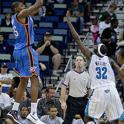 Oct 10, 2009; New Orleans, LA, USA;  Oklahoma City Thunder forward Kevin Durant (35) shoots over New Orleans Hornets forward Julian Wright (32)  during a preseason game at the New Orleans Arena. The Hornets defeated the Thunder 88-79. Mandatory Credit: Derick E. Hingle-US PRESSWIRE