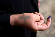 An Egyptian Coptic Christian woman with a cross tatooed on her wrist  has her index finger marked with idigo colored ink , a marking used to officially confirm one has voted after Egyptians  women vote at a polling station in the El Mokattam neighborhood of  Cairo , Egypt May 23, 2012. Egyptians head to the polling stations throughout Egypt  Wednesday for an historic opportunity in which they will for the first time to pick their president in a wide open election that pits Islamists against men who served under deposed leader Hosni Mubarak.(Photo by Heidi Levine/Sipa Press).