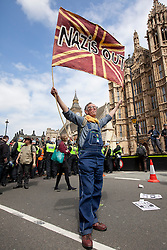 © Licensed to London News Pictures. 01/06/2013. London, UK. Supporters of Unite Against Fascism (UAF) are seen in central London today after they broke through a police cordon to confront British National Party (BNP) supporters who were demonstrating in central London today (01/06/2013). The BNP protest was held in response to the killing of Drummer Lee Rigby, who died after an attack in Woolwich where religious extremism may have been the motive. Photo credit: Matt Cetti-Roberts/LNP