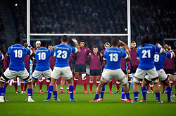 England players look on as Samoa perform the Siva Tau prior to the match - Photo mandatory by-line: Patrick Khachfe/JMP - Mobile: 07966 386802 22/11/2014 - SPORT - RUGBY UNION - London - Twickenham Stadium - England v Samoa - QBE Internationals