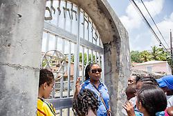Tour leader Nadine T. Marchena Kean speaks about the Jewish cemetery in use in historic Savan.  The Virgin Islands Economic Development Association Enterprise & Commercial Zone Commission hosts a historical tour through the Savan (Savanne) neighborhood.   St. Thomas, US Virgin Islands.  9 July 2015.  © Aisha-Zakiya Boyd