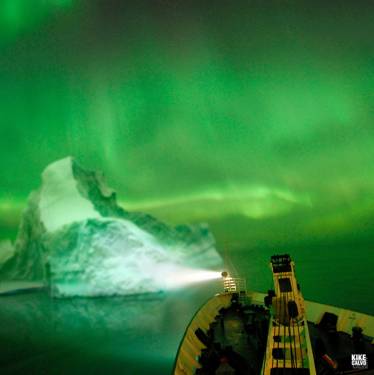 Northern lights or Aurora borealis on the Arctic night sky, viewed from Orlova Russian Icebreaker, High Arctic. Canada.( night, nocturnal, show, colorful, green, red, spectacule, weather, atmosphere,