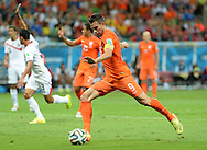 Robin van Persie of Netherlands shoots for goal during the 2014 FIFA World Cup match at the Itaipava Arena Fonte Nova, Nazare, Bahia<br /> Picture by Stefano Gnech/Focus Images Ltd +39 333 1641678<br /> 05/07/2014