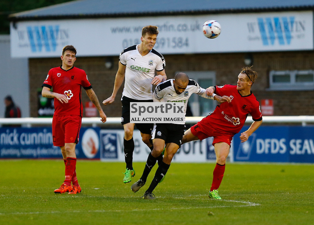 Dover's defender Sean Raggett (5) rises to the ball over team mate Dover's defender Richard Orlu (6). Dover Athletic v Barrow. Vanarama National League. 10  November 2015. (c) Matt Bristow   SportPix.org.uk