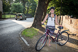 © Licensed to London News Pictures . 09/07/2013 . Manchester , UK . TERRI CASS (26) , from Eccles , was unable to get home due to the bridge 's closure so stood on her own at the Ellesmere Circle roundabout directing traffic away from Redclyffe Road , preventing worse traffic problems . The Barton Road Swing Bridge which links Redclyffe Road and Barton Road over the Manchester Ship Canal , was stuck open today after heat caused the metal frame to expand whilst it was opened to allow a boat to pass beneath . A fire crew doused the metal structure with water to cool it down until it contracted sufficiently to allow the bridge to swing closed . Rush hour traffic backed up for several miles around the Trafford Centre and M60 as a consequence of the road's one-and-a-half hour closure . Photo credit : Joel Goodman/LNP Video available here.. http://www.youtube.com/watch?v=ySGwDNzhH8o