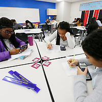 Thomas Wells   BUY AT PHOTOS.DJOURNAL.COM<br /> Elana Dearing, from left, D'Serriqka Thomas and Morelia Morel Diaz get used to the new student workstations that can be combined to make working together easier.