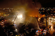 Reno firefighters work on containing a four-alarm fire at the Mizpah Hotel in downtown Reno, Nev. on Oct. 31, 2006.  About 31 people were injured and one fatality was reported, according to Steve Frady, Reno fire information officer.  The cause of the fire is under investigation, but according to Frady, it is a criminal investigation.<br /> (AP Photo, Kevin Clifford/Nevada Appeal).
