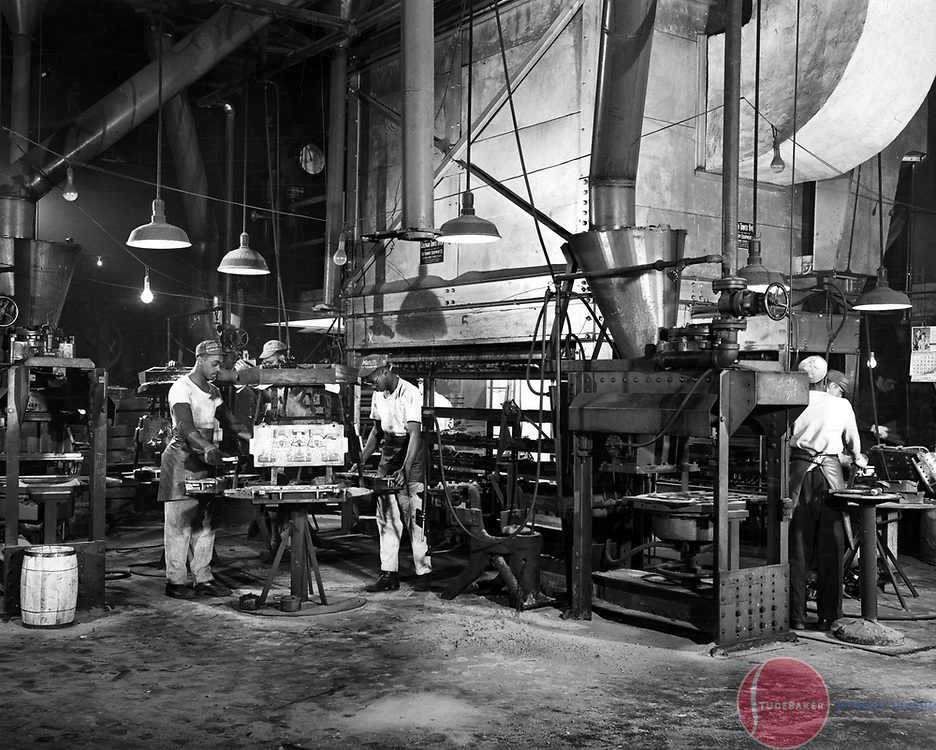 Studebaker Foundry workers prepare casting cores (patterns) for the casting process.