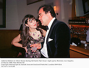 Juliette Hohnen & Oliver Stone during theVanity Fair Oscar  night party, Mortons, Los Angeles. 23 March 1988. Film 981061f30<br />