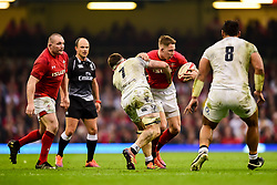 George North of Wales is tackled by Tom Curry of England - Mandatory by-line: Ryan Hiscott/JMP - 23/02/2019 - RUGBY - Principality Stadium - Cardiff, Wales - Wales v England - Guinness Six Nations