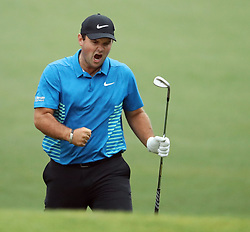 April 7, 2018 - Augusta, GA, USA - Patrick Reed celebrates his eagle chip on the 15th hole during the third round of the Masters Tournament on Saturday, April 7, 2018, at Augusta National Golf Club in Augusta, Ga. (Credit Image: © Jason Getz/TNS via ZUMA Wire)