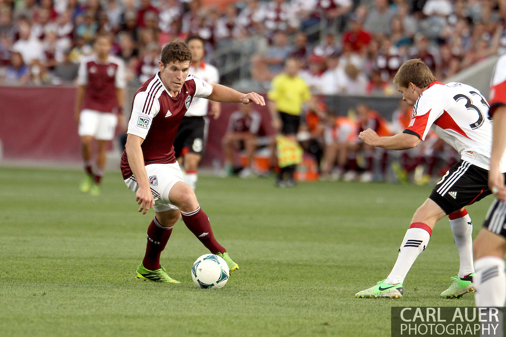 July 7th, 2013 - Colorado Rapids midfielder Dillon Powers (8) makes a move towards the goal in the first half of action in the Major League Soccer match between D.C. United and the Colorado Rapids at Dick's Sporting Goods Park in Commerce City, CO